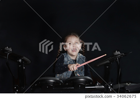 Little caucasian girl drummer laughting 34062675