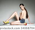 Beautiful naked woman wear high heels. 34068704