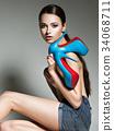 Beautiful woman holds high heels. Fashion  34068711