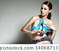 Beautiful woman holds high heels. Fashion girl 34068713