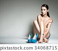 Beautiful woman holds high heels. Fashion  34068715