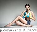 Beautiful woman holds high heels. Fashion  34068720