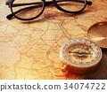 gold vintage compass on vintage map 34074722
