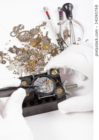 repair of mechanic watch with spare parts - Stock Photo [34090768
