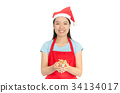 Asian woman wear Santa Claus hat and hold gift box 34134017