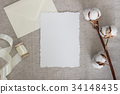 Torn edge paper card on linen cloth with cotton 34148435