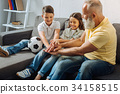 Children and their grandfather holding hands on 34158515