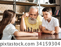 Grandfather and grandson planning their next move 34159304