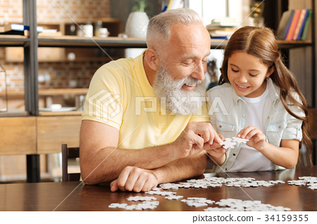 Granddaughter and grandfather trying to join two 34159355