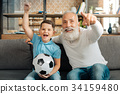 Grandfather and grandson celebrating important 34159480
