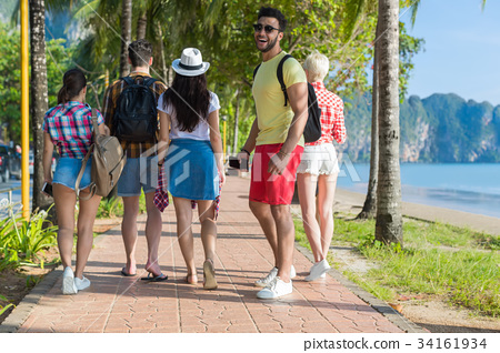 Latin Man And People Group Walking In Palm Tree 34161934