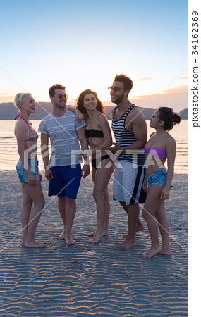 Young People Group On Beach At Sunset Summer 34162369
