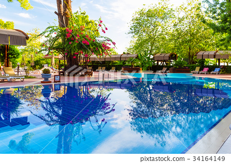 Beautiful blue swimming pool and chair 34164149