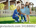 Portrait of a happy family near their new house 34166662