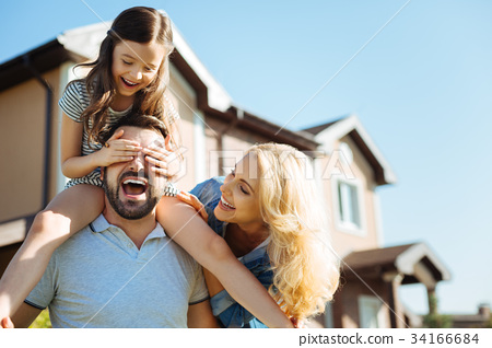 Mother and father having fun with their daughter 34166684