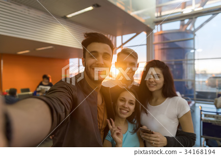 Young People Group In Airport Lounge Waiting 34168194