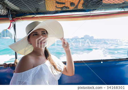 Attractive Young Caucasian Woman Sit On Boat Wear 34168301