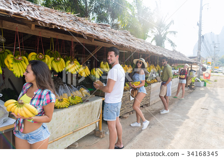 People Group Buying Bananas And Pineapples On 34168345