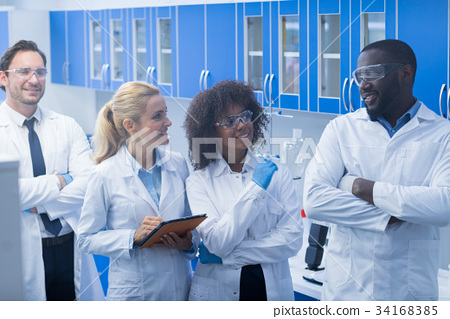 Group of Laboratory Scientists Listen To African 34168385
