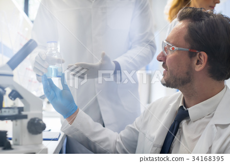 Male Scientist Taking Flask In Laboratory From 34168395