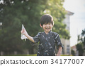Cute Asian child in kimono  running and look back 34177007