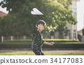 Cute Asian child playing in the park 34177083