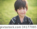 Asian boy in kimono with green field background 34177085