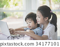 Asian children using tablet together 34177101
