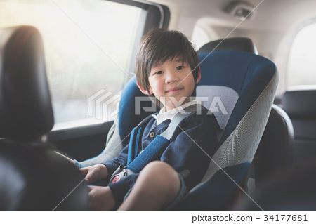 Portrait of cute Asian child sitting in car seat 34177681