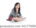 asian girl sitting on white background isolated 34177688