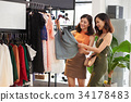 Shopping in apparel store 34178483