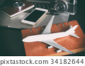 Toy plane with travel objects for business travel 34182644
