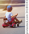 Happy boy standing on hoverboard or gyroscooter with kart access 34184343