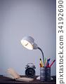 Illuminated electric lamp on table 34192690