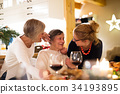 Mother, grandmother and daughter celebrating 34193895