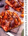 Slicesd german plum cake 34194289