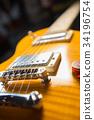 Close up of an electric guitar bridge 34196754