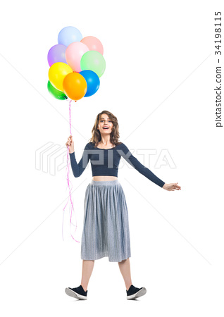 Surprised beautiful woman holding colorful balloons and having f 34198115