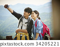The couple is taking selfie in the mountain 34205221