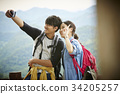 The traveller couple is talking selfie on their trip 34205257