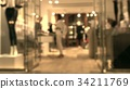Blurred female customer and sales assistant in the 34211769
