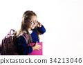 Caucasian elementary age schoolgirl with glasses 34213046