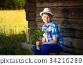 Adorable boy in hat with a bouquet of flowers 34216289