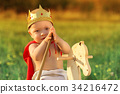 Little Prince with a crown on the head 34216472