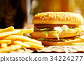Burger on craft paper with fries and coke on 34224277