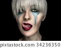 Halloween woman vampire with creative art make up 34236350