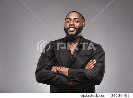 Cheerful young  African American man in full suit  34236405