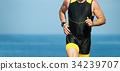 Man runner running on triathlon race on sunny days 34239707