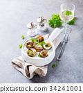 Snails with garlic herbs butter 34241001