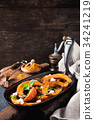 Roasted pumpkin with addition aromatic herbs 34241219